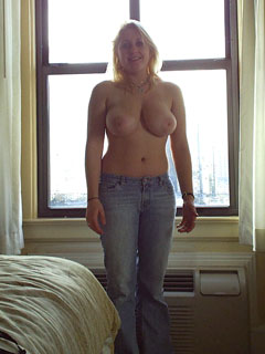 Girl with bigger breasts in her room